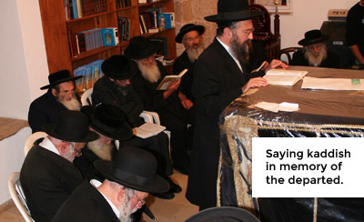 A group of people offering a Kaddish recitation service